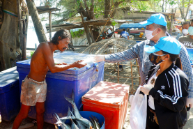 PKRU helps prevent COVID–19 by giving face-masks to sea gypsies in Rawai Beach